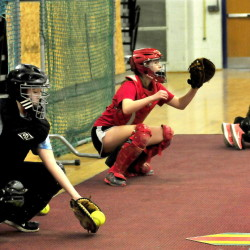 Messalonskee High School catchers practice with pitchers on the first day of practice Monday in Oakland. From left are Kaylee Burbank, Taylor Easler and Dakota Bragg.