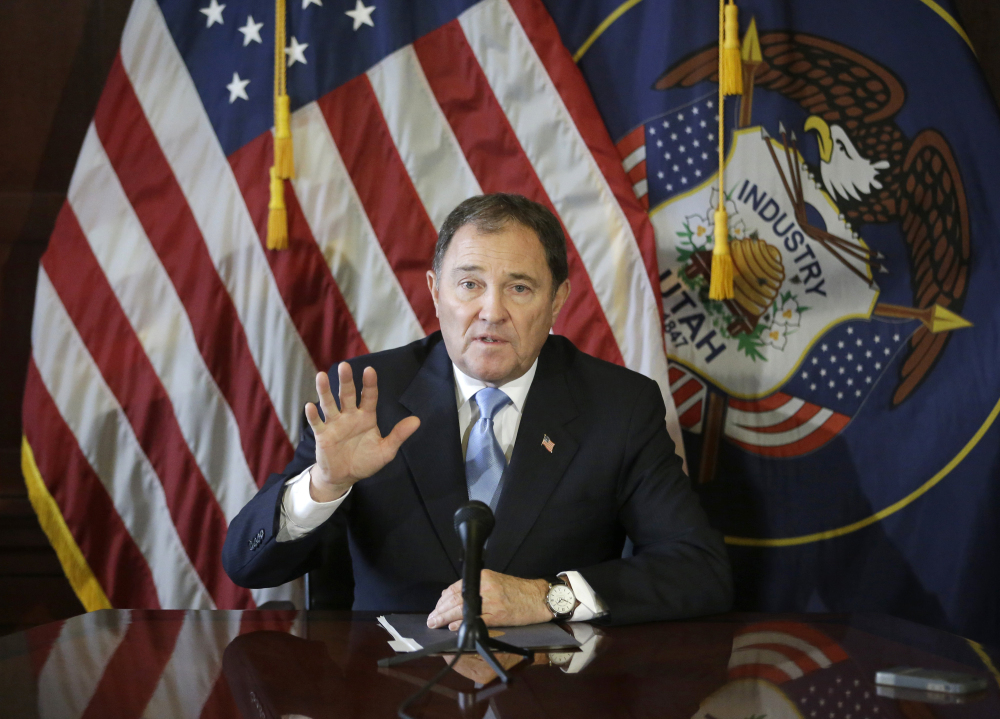 In this Feb. 5, 2015, file photo, Utah Gov. Gary Herbert speaks to members of the media during a news conference at the Utah State Capitol, in Salt Lake City.