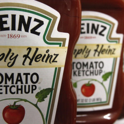 This Wednesday, March 2, 2011, file photo, shows containers of Heinz ketchup on the shelf of a market, in Barre, Vt. H.J. Heinz Co. is buying Kraft Foods Group Inc., creating what the companies say will be the third-largest food and beverage company in North America, the companies announced Wednesday.