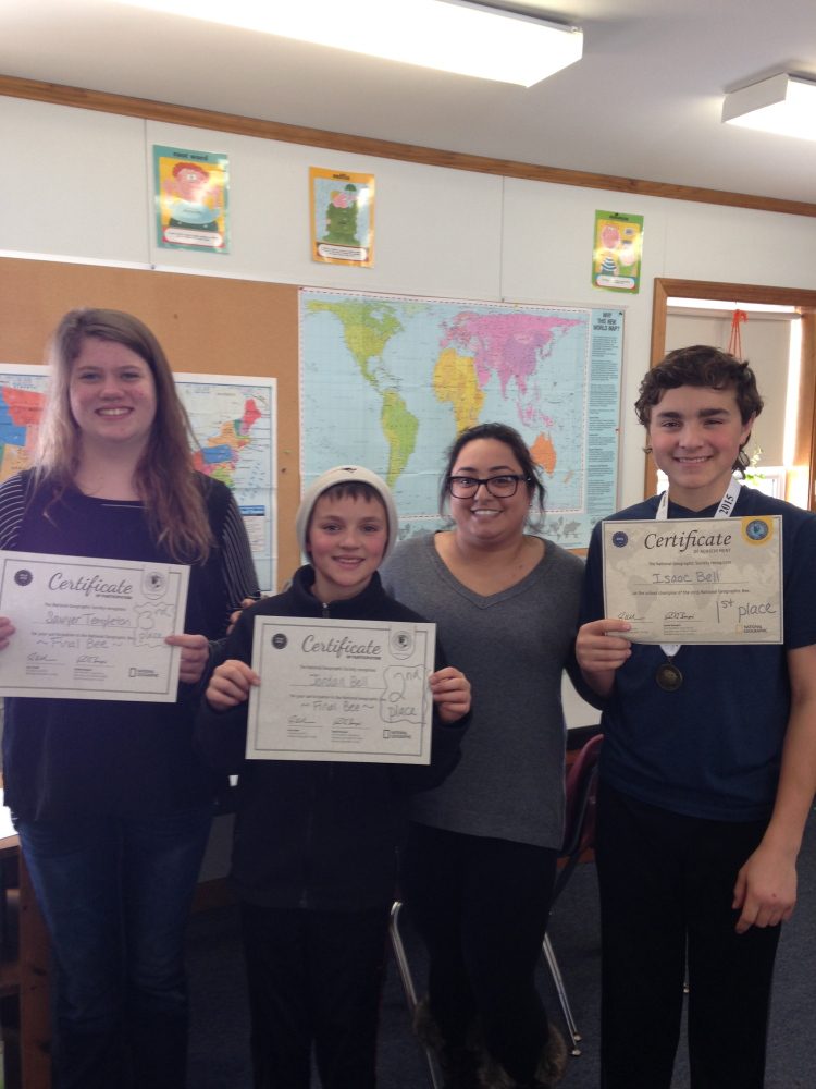 School-level National Geographic Bee, from left, were Sawyer Templeton, third place; Jordan Bell, second; Hannah Sher, moderator; and Isaac Bell, first.
