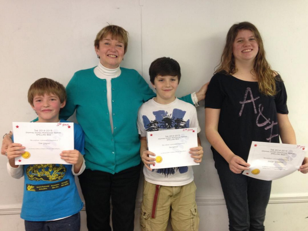 Kennebec County Spelling Bee, from left, Tom Gingras, winner; Su Locsin, school bee moderator; Ian Gervais, runner up; and Sawyer Templeton, third.