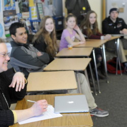 Maranacook Community High School teacher Carrie Emmerson leads a discussion Monday at the Readfield school about a stereotype workshop she attended with students recently.