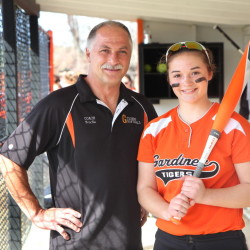 Photo by Jeff Pouland   Gardiner assistant softball coach Don Brochu poses with his daughter Brie before a game last year. Brochu returns as the head coach this season.