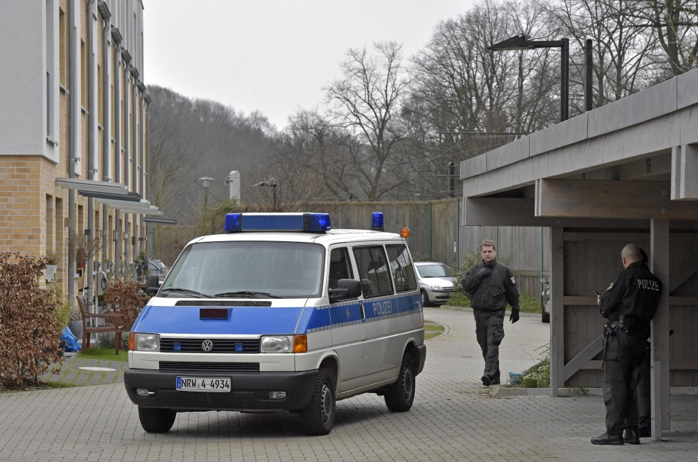 """Police officers block a street where the co-pilot of the crashed Germanwings airliner jet is supposed to have lived lived in an apartment, in Duesseldorf, Germany, Thursday in connection with investigations of the crash of the aircraft in the French Alps on Tuesday, which killed 150 people. The co-pilot of the doomed Germanwings jet barricaded himself in the cockpit and """"intentionally"""" sent the plane full speed into a mountain in the French Alps, ignoring the pilot's frantic pounding on the door and the screams of terror from passengers, a prosecutor said Thursday."""