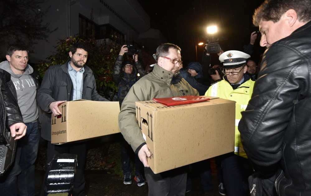 """Investigators carry boxes from the apartment of Germanwings co-pilot Andreas Lubitz on Thursday in Duesseldorf, Germany. French prosecutors said Lubitz """"intentionally"""" crashed Flight 9525 into the side of a mountain Tuesday in the French Alps."""