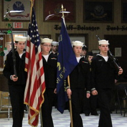 The color guard parading the colors, from left, E-3 Conner Fennell, E-3 Trevor Edes, E-2 Zebediah Gagne and E-3 Jonathen Jackson.
