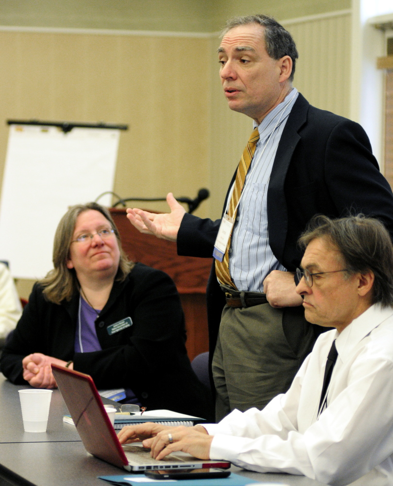 Dennis Culley, staff attorney for the Legal Services For the Elderly, speaks on Thursday during a panel discussion at the Maine Hospital Association in Augusta. Jessica Maurer, executive director of the Maine Association of Area Agencies on Aging, left, and Dr. Lewis Mehl-Madrona, director of the geriatrics fellowship at Maine Dartmouth Family Medicine Residency in Augusta, also spoke at the event.