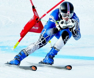 Colby College's Mardi Haskell races to the finish line during the women's giant slalom race Thursday the U.S. Alpine Championships at Sugarloaf Mountain.