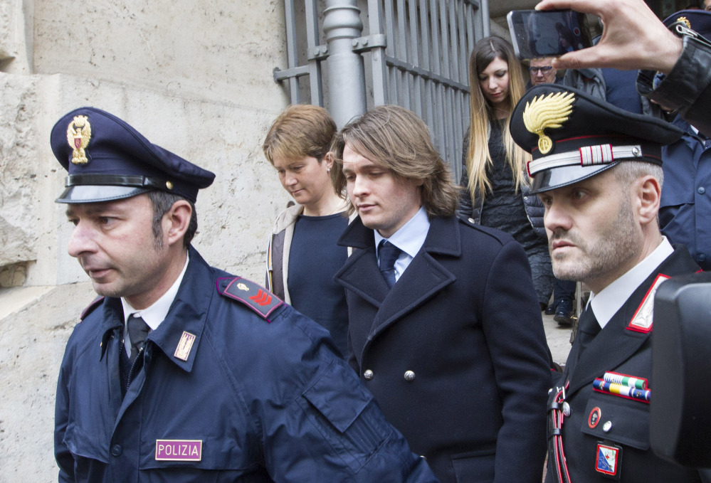 Raffaele Sollecito, center, leaves Italy's highest court building with his girlfriend, Greta Menegaldo, in Rome on Friday. He and Amanda Knox expect to learn their fate when Italy's highest court hears their appeal of their guilty verdicts in the brutal 2007 murder of Knox's British roommate Meredith Kercher.
