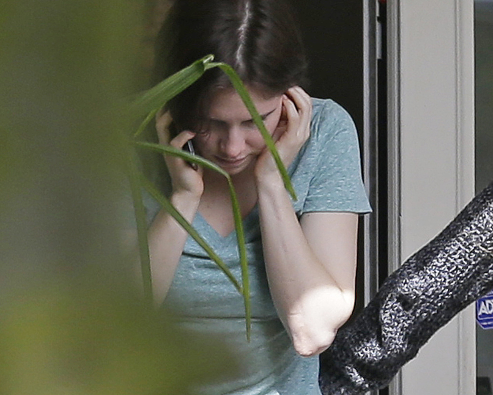 Amanda Knox talks on a phone Friday in the backyard of her mother's house in Seattle. Italy's highest court overturned the murder conviction against Knox and her ex-boyfriend Friday in the 2007 slaying of Knox's roommate, ending the high-profile case.