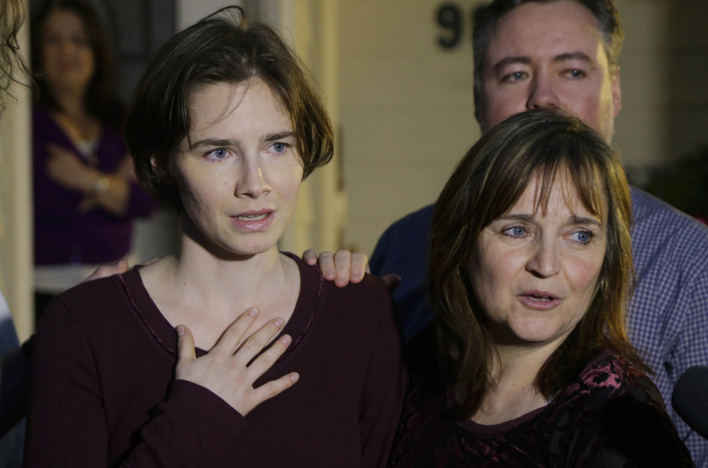 Amanda Knox, left, stands with her mother, Edda Mellas, and talks to the media outside Mellas' home in Seattle on Friday. Italy's highest court overturned the murder conviction of Knox and her ex-boyfriend Friday in the 2007 killing of Knox's roommate, ending the high-profile case.