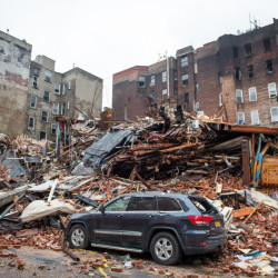A pile of debris remains Friday at the site of a building explosion in New York. Mayor Bill de Blasio said someone may have improperly tapped a gas line before Thursday's explosion.