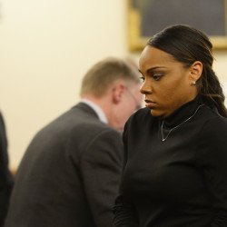 Shayanna Jenkins, fiancee of former New England Patriots football player Aaron Hernandez, seen at left, walks away after testifying at Hernandez's trial on Friday in Fall River, Mass.