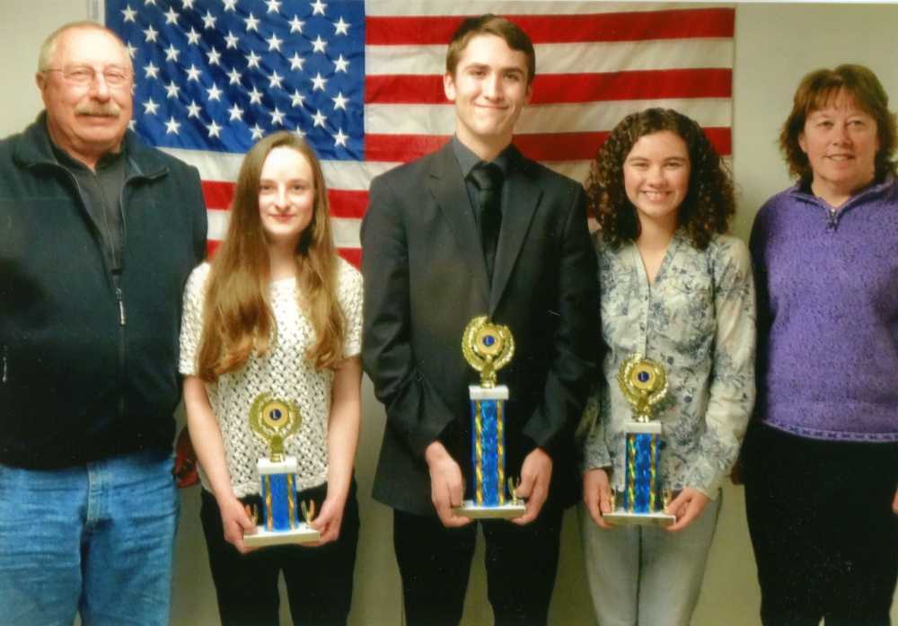 Monmouth Lions Club recently held its 2015 Speak-Out event. From left, are Coach Scott Foyt, third-place winner Jordyn Mann, first-place winner Angus Koller, second-place winner Kim Lewis and Coach Cathy Foyt.