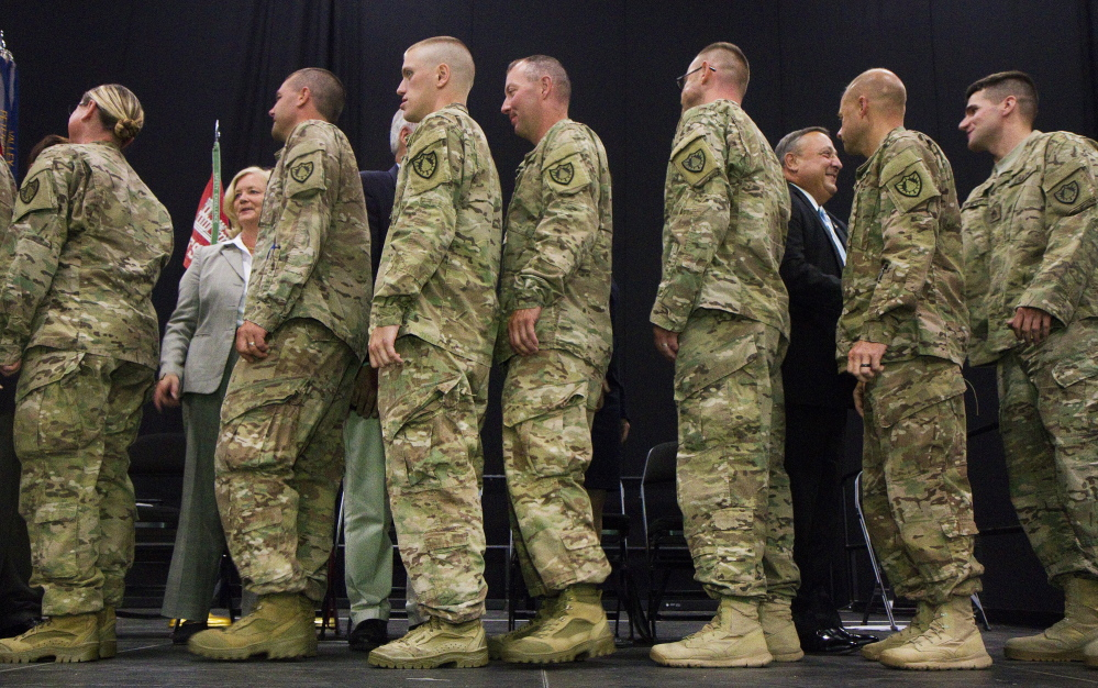 Members of Maine's 133rd Engineer Battalion, back from deployment in Afghanistan, are honored during a ceremony at the Colisee in Lewiston on August 17. (Press Herald file photo by Carl D. Walsh