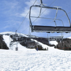 Chairs hang motionless and unused 12 feet above the snow Monday at the base of the Sugarloaf ski resport's King Pine chairlift in Carrabassett Valley after a lift accident there on March 21.