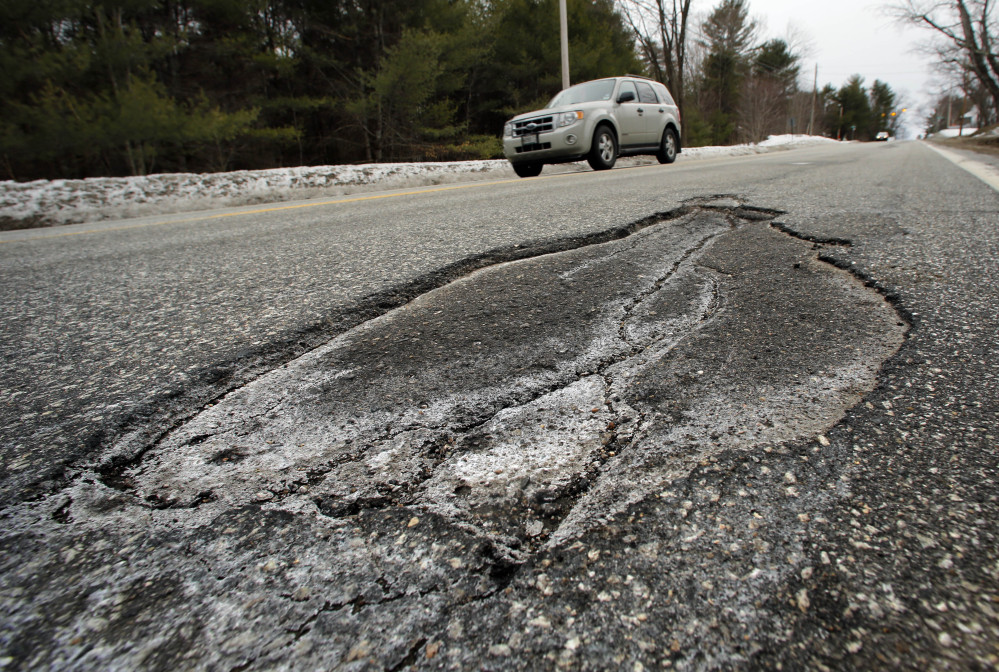 Potholes, like this one on Route 302 in Fryeburg, will plague New England this mud season. The expansion and contraction of asphalt during spring, when days are warm and nights are below freezing, will undoubtedly keep work crews busy repairing roads that have already been battered throughout the brutal winter experienced in northern New England.