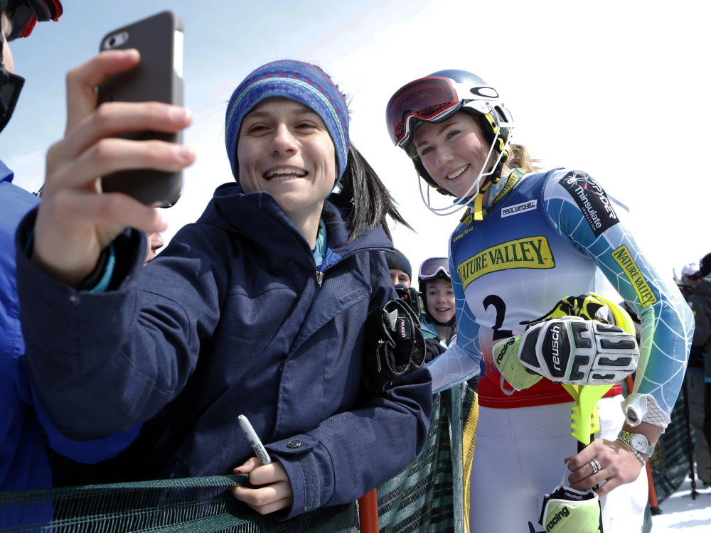 Maria Cavallaro, 14, of North Andover, Mass., snaps a selfie with Mikaela Shiffrin after Shiffrin won the women's slalom ski race at the U.S. Alpine Championships on Saturday at Sugarloaf Mountain Resort in Carrabassett Valley.