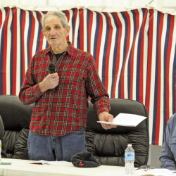 Selectman Mert Hickey, center, responds to a question from Heidi Peckham during the annual West Gardiner Town Meeting on Saturday in the town fire station. Selectmen Earl McCormick, left, and Greg Couture, chairman of the Board of Selectmen, listen.