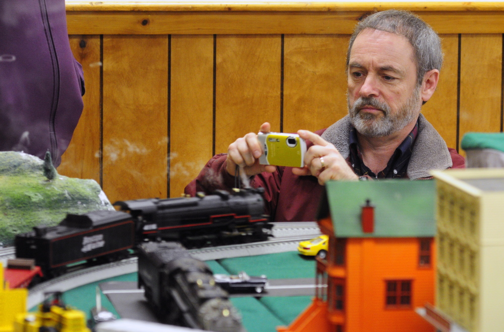 Earl Pollock takes a photo of an engine at the Maine3Railers model railroad show on Saturday at the Elks Club in Augusta.