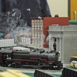 Smoke puffs from a steam engine as it runs around a model layout during the Maine3Railers model railroad show on Saturday at the Elks Club in Augusta.
