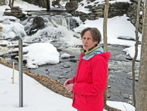 Jennifer Irving, executive director of the Sebasticook Regional Land Trust, stands near the Box Mill dam on Outlet Stream on Friday in North Vassalboro.