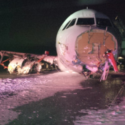 "An Air Canada Airbus A-320 sits at Halifax International Airport after an ""abrupt"" landing on Saturday night. The Airbus 320 skidded off the runway at the Halifax airport in bad weather, and officials said 23 people were taken to a hospital for observation and treatment of minor injuries. None of the injuries were considered life threatening, Air Canada said."