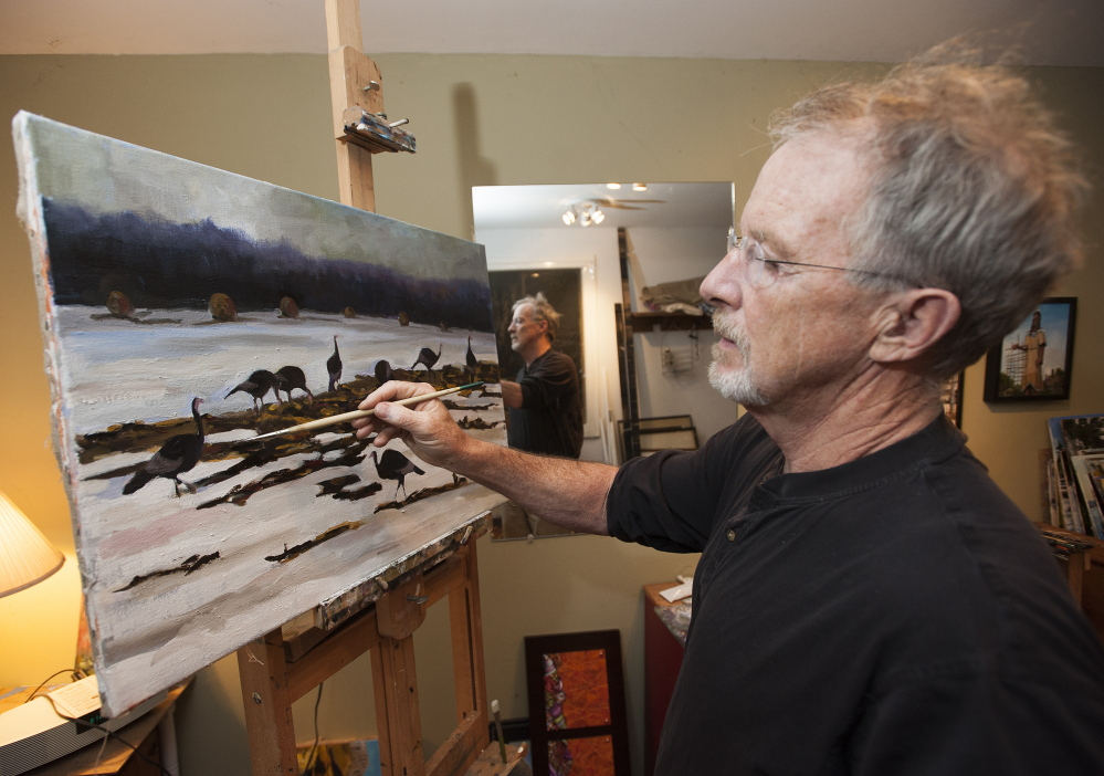 Former defense attorney turned Assistant Attorney General John Alsop works on a painting of turkeys in a snow covered field at his studio in his Cornville home.
