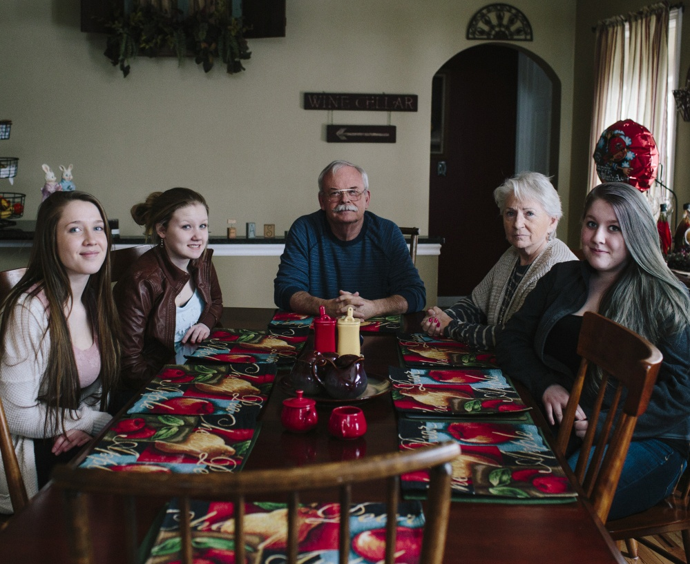 The Farrington family of South China includes foster parent Neil, center, his wife, Doreen, and from left, teenagers Hannah, Ashley and Amanda. The Farringtons have taken in about 75 Maine foster children – mostly teenagers – over the past 20 years.