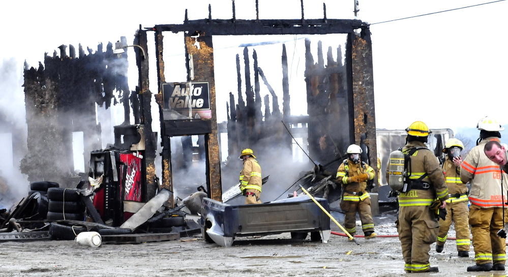 Firefighters extinguish fire that destroyed Ray's Auto garage in North Belgrade on Monday.