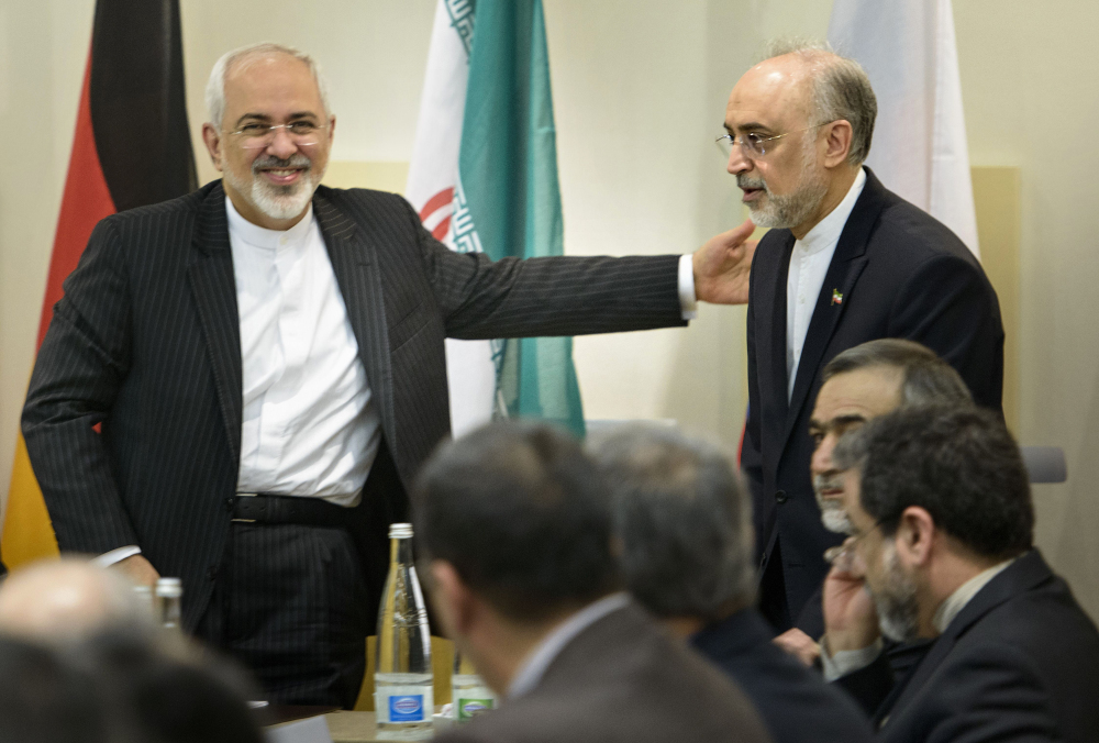 Iranian Foreign Minister Javad Zarif, lefts, greets Ali Akbar Salehi, head of Iran's Atomic Energy Organization, upon the latter's arrival for a meeting on Iran's nuclear program Tuesday with officials from Britain, China, France, Germany, Russia, the United States and the European Union. Diplomats meeting in Lausanne, Switzerland, worked past their deadline to reach consensus on the outline of deal.