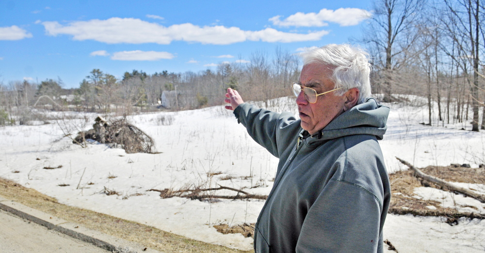 Dan Moscato talks about a solar power development proposed for a field near his home on Tuesday in Washington. The town is holding a special town meeting next week, at which selectmen are seeking a six-month moratorium on such developments to give the Planning Board time to review any concerns the town might have.