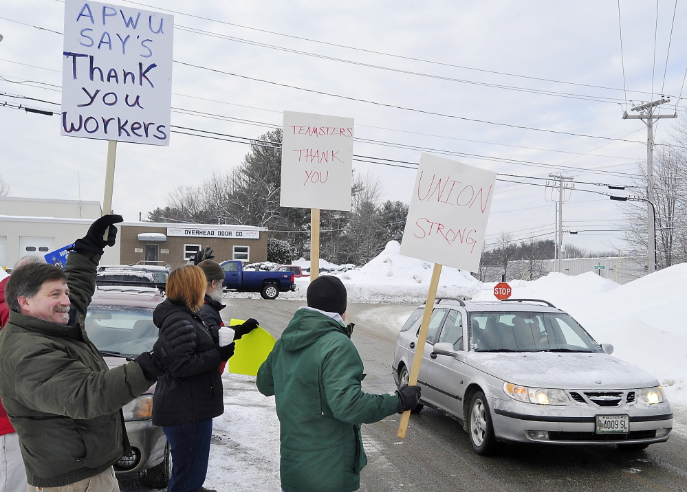 PORTLAND, ME - FEBRUARY 25: Tim Doughty, a postal worker with the American Postal Workers Union, left,  joins State Rep. Mark Bryant, Doug Born, Jen Nappi, and Joe Piccone of the Teamsters, as they thank Fairpoint workers returning to work on Davis Farm Road after a long strike. (Photo by Gordon Chibroski/Staff Photographer)