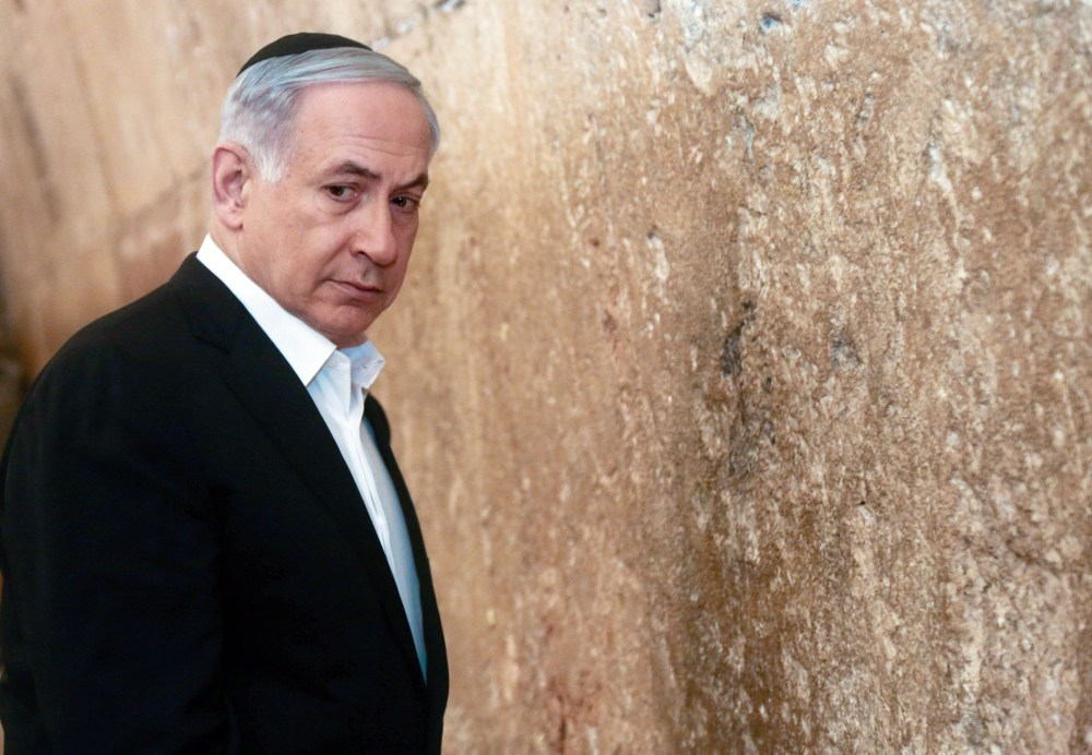 Israeli Prime Minister Benjamin Netanyahu looks on before praying at the Western Wall, the holiest site where Jews can pray, in Jerusalem's Old City, Saturday.