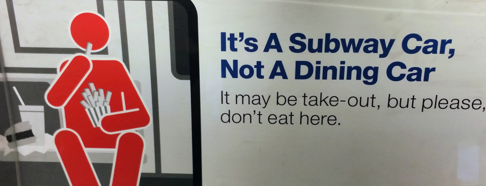 A placard reminds passengers to let the meal wait until the ride is over.