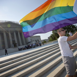 Vin Testa of Washington waves a rainbow flag in support of gay rights outside the Supreme Court in Washington in June 2013.  The Supreme Court will hear arguments over same-sex marriage on April 28.
