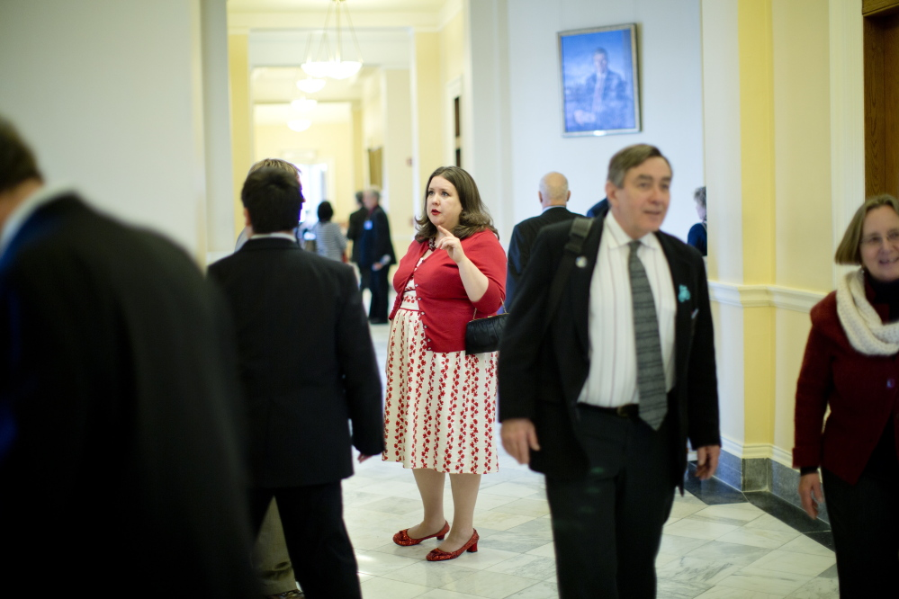 State Rep. Diane Russell speaks with constituents in a State House hallway. Russell has long been a Democratic Party leader on medical marijuana. She staked out her position early, when the issue was much more controversial, doing so at the risk of becoming an outsider.