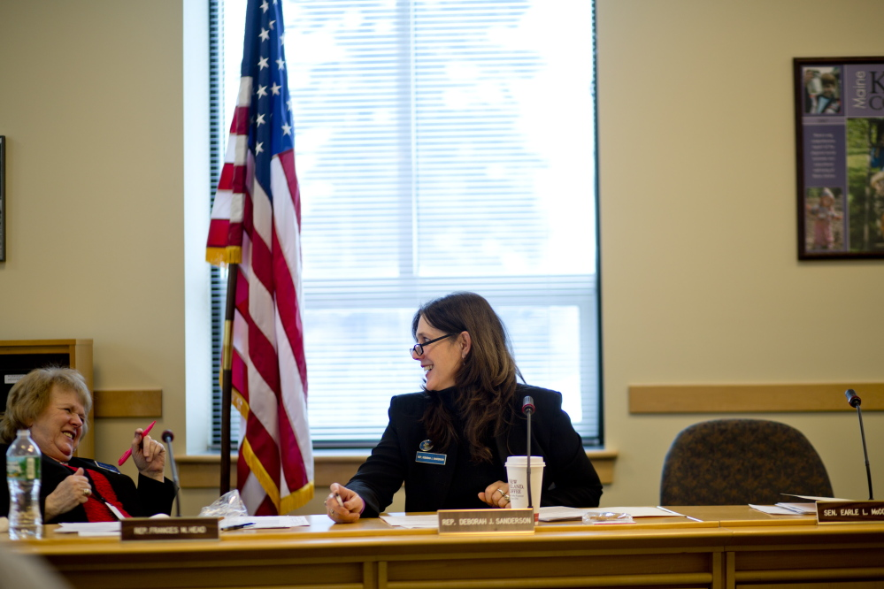 State Rep. Deborah Sanderson, right, talks with Rep. Frances M. Head, R-Bethel, before a February hearing at the Cross State Office Building in Augusta. In 2009, Sanderson opposed expanding Maine's Medical Marijuana Act, but after research years later, she changed her position.