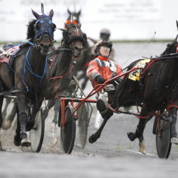 Harness-racing drivers compete at Scarborough Downs. The track is being sued for allegedly not paying a bill.