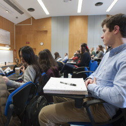 University of Maine freshman Joshuah Salkind listens as Dr. James Breece lectures on macroeconomics Thursday. Salkind, who graduated from a very small Maine high school, chose UMaine for the large-university experience.