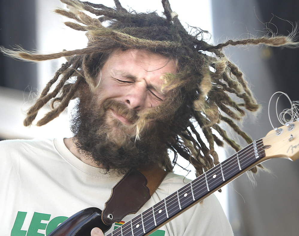 Jay Harris, lead guitarist with Soul Rebel Project, entertains the crowd last August during the first Reggae Festival held at the Maine State Pier in Portland.