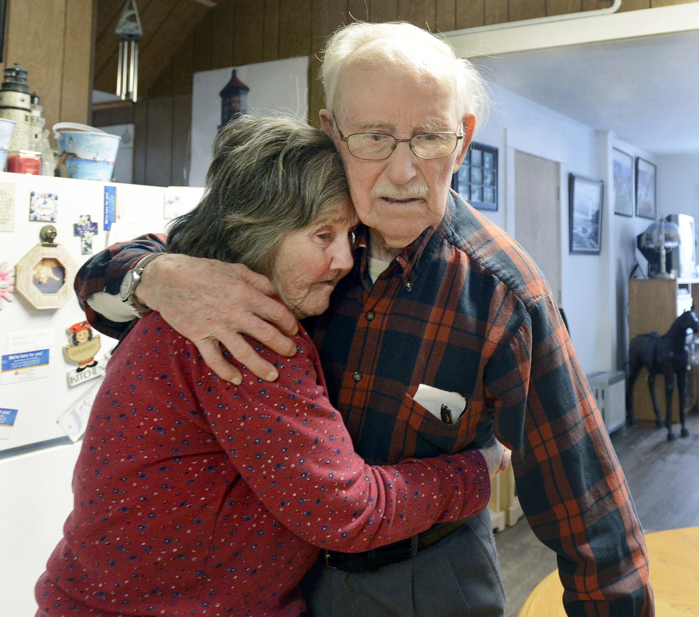 """After escaping from an assisted-living center in Sanford on Tuesday, 91-year-old Real L'Heureux embraces 77-year-old Grace Harakles in the kitchen of her Sanford home. To authorities, how L'Heureux managed to leave the locked dementia-care facility remains a mystery. """"You find a way,"""" he said."""