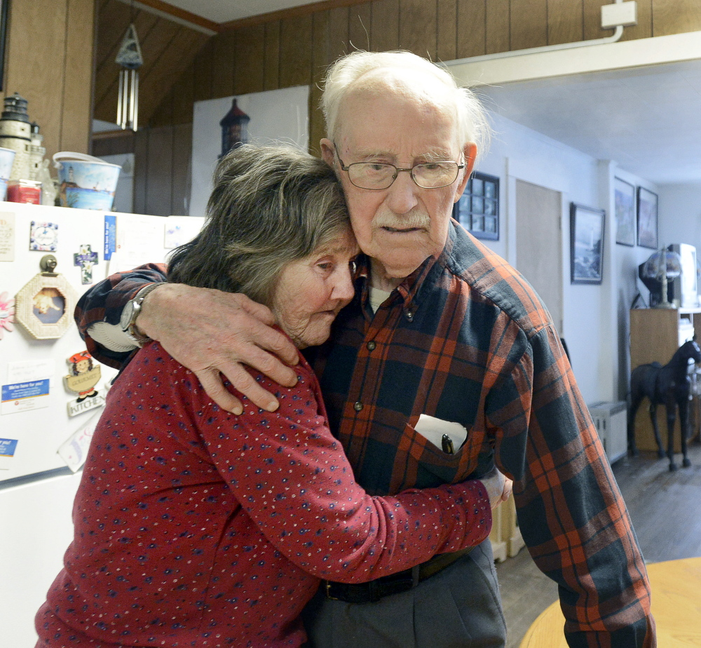 Real L'Heureux embraces Grace Harakles in the kitchen of her Sanford home Tuesday. On Wednesday, he returned to the locked memory-care facility where he has been living.
