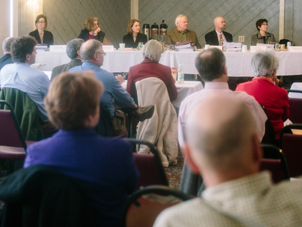 Nearly 200 people pack the Brunswick Golf Club on Wednesday to hear testimony and later speak for or against the proposed Downeaster layover facility that some fear would pose threats to groundwater. Others said pollution from cars poses the greater threat.