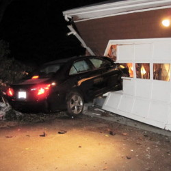 This 2012 Toyota was left lodged in the garage at 295 Summit St. in Portland after its driver hit the building and fled early Wednesday morning.