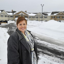 Bellavita executive director Melissa Craig stands near the senior apartment complex set to open this spring in Scarborough. The first Maine property of the nation's largest senior housing developer will charge rents starting at $4,200 per month.