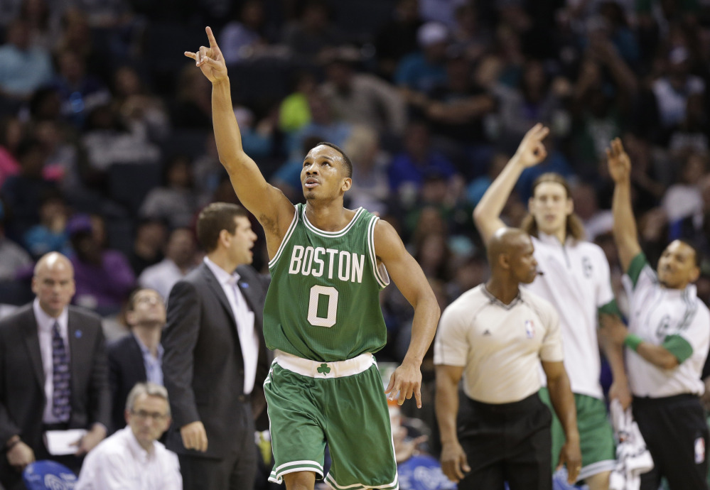 The Celtics' Avery Bradley celebrates after making a three-point basket in the second half Monday night against the Charlotte Hornets. The Celtics won, 116-104, with Bradley leading the team with 30 points.