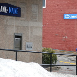 People walk out of The Bank of Maine branch, left, and Camden National Bank on Water Street in Gardiner Monday.  Camden National Bank and The Bank of Maine announced a plan to merge today, which if successful would create a new bank that surpasses Bangor Savings Bank as the largest bank headquartered in Maine.  Formerly Gardiner Savings, Bank of Maine has had a presence in Gardiner since the middle of the 19th Century. Staff photo by Andy Molloy