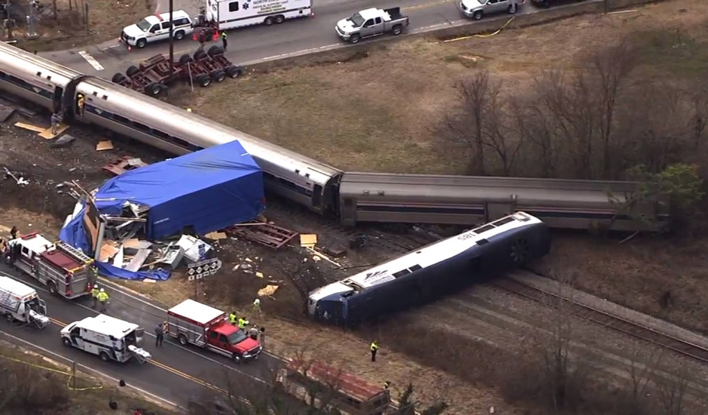 In this frame grab from video provided by WTVD-11, authorities respond to a collision between an Amtrak passenger train and a truck Monday in Halifax County, N.C.