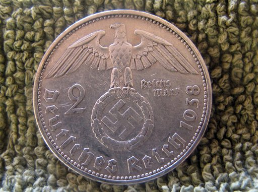 A German coin from 1938 found in the remains of a house built inside Teyu Cuare Park, near San Ignacio in the northeastern province of Misiones, Argentina. Archaeologists say ruined buildings in an Argentine nature reserve might have been planned as a World War II-era hideout for top Nazi officers. (AP Photo/University of Buenos Aires Urban Archeology Center)